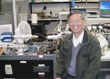 Dr. Li from Bejing beside my helium mass spec in my lab near San Francisco a few years back.