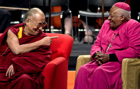 The Dalai Lama shares a laugh with Archbishop Desmond Tutu as they both take part in a dialogue on youth and spiritual connection in Seattle