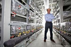 Italian engineer Rossi staind inside one of his megawatt cold fusion power plants like one now online powering a US coprporation commercial production line.